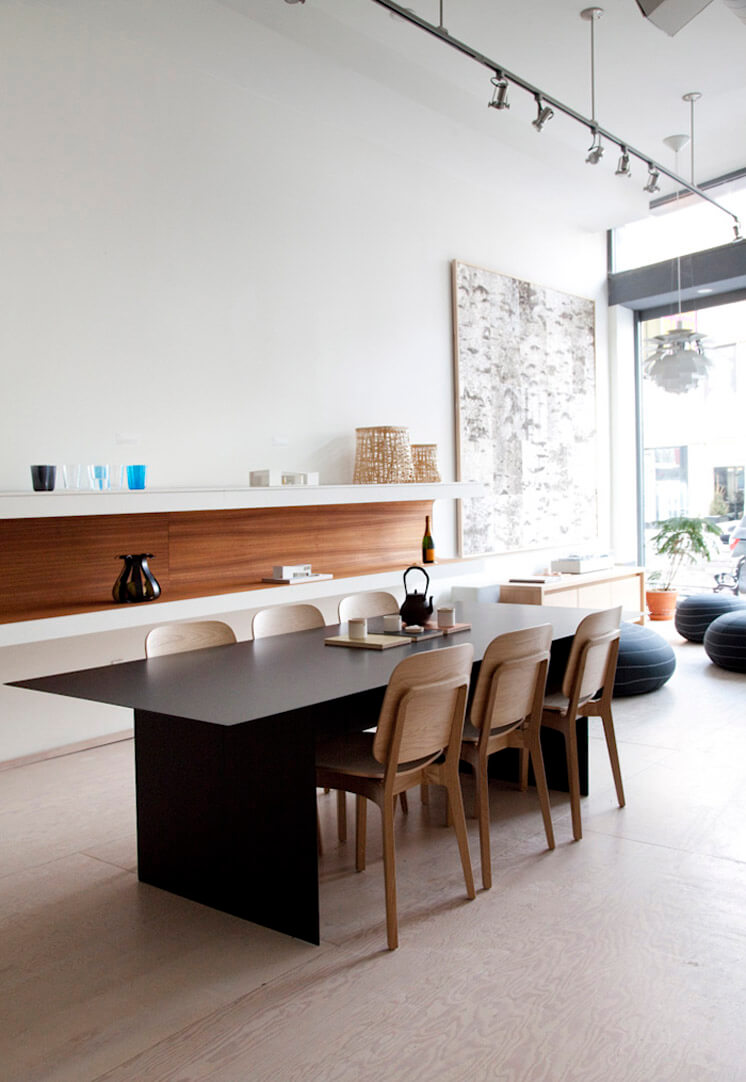 Mjolk The Kami table for Discipline in black paired with 6 Röhsska chairs for Swedese in white oak Est Magazine