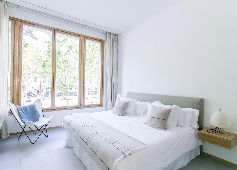 est living margot house barcelona guest room butterfly chair