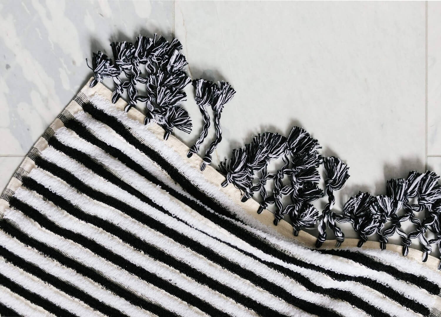 Picture of: Loom Black And White Stripe Bath Mat Est Living Design Directory