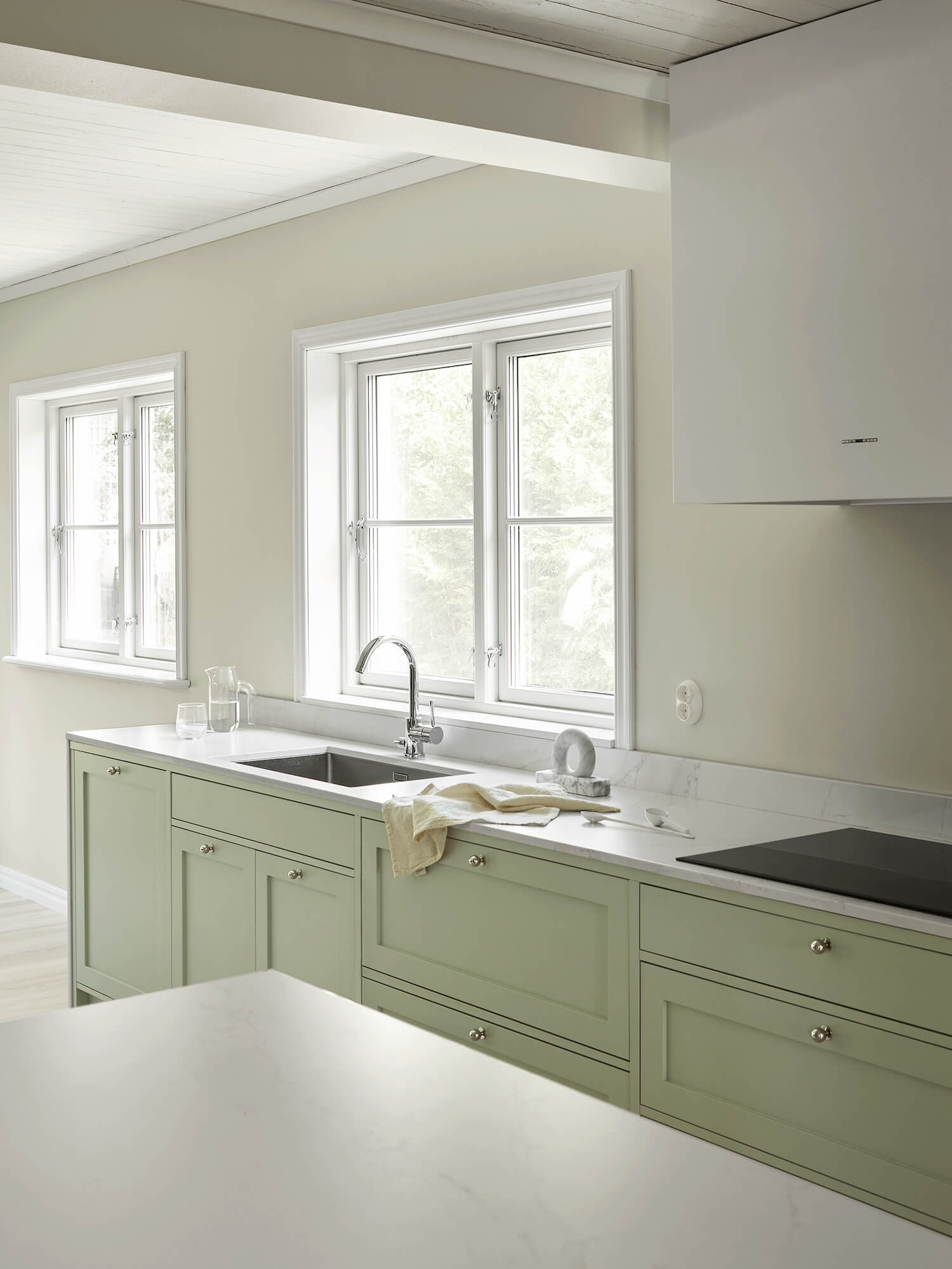 Pale Green Shaker Kitchen by Nordiska Kok | Designing a Nordic-Style Kitchen