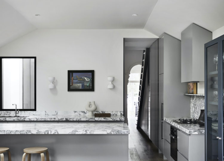 Grey & White Kitchen with Island Marble Benchtop and view of staircase